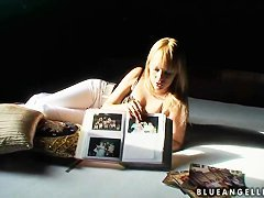 Blue Angel shows photo album in sexy outfit