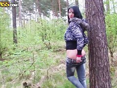 Busty black haired Ella gets naughty outdoor